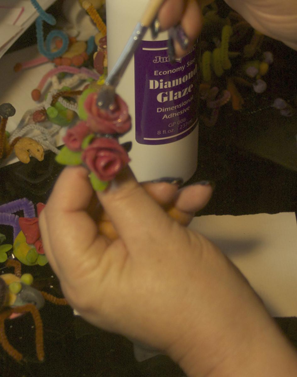 Glaze with Diamond Glaze after it dries.