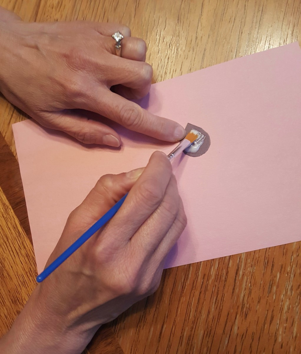 Spread The Dot Of Glue With A Paintbrush