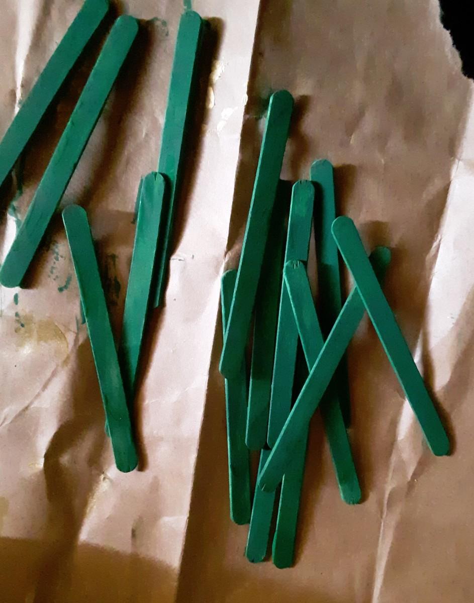 Paint the sticks.