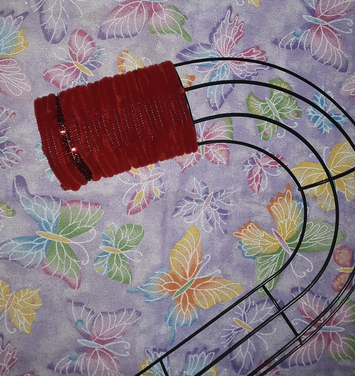 Continue to weave the sticks through the frame until a section of the cane is red.