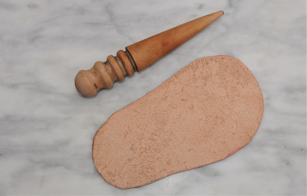 Burnishing tool and the leather outer sole.