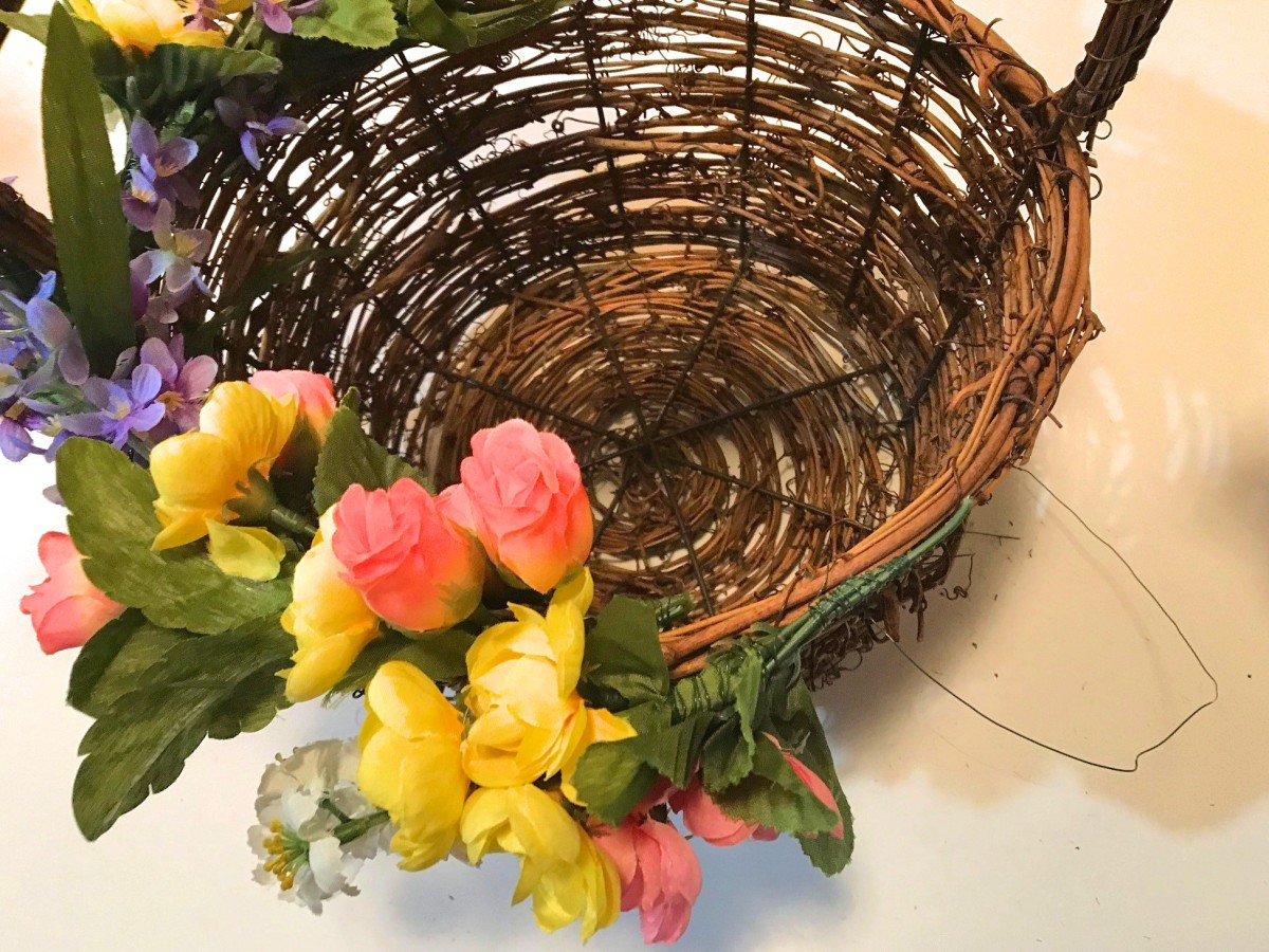 Use the same process to add floral stems to the basket rim. Always tuck in wire ends.