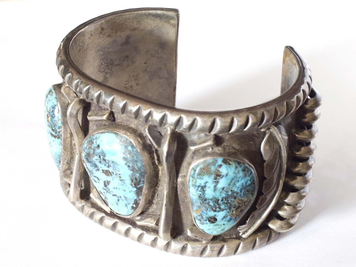 A hand-crafted Navajo silver and turquoise cuff bracelet.  I photographed this beautiful piece of vintage artwork for a listing on eBay.  Processed with Helicon Focus.