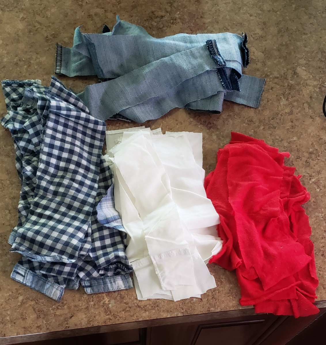 Cut your fabric into strips. Separate them into piles.