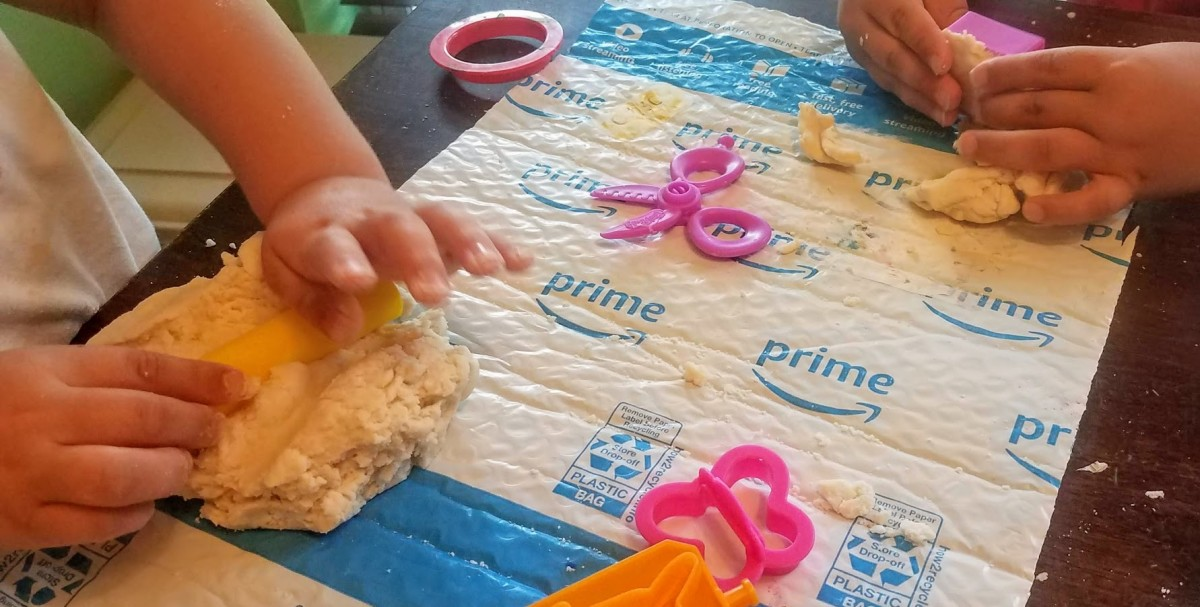 My kids playing with flour and salt playdough.