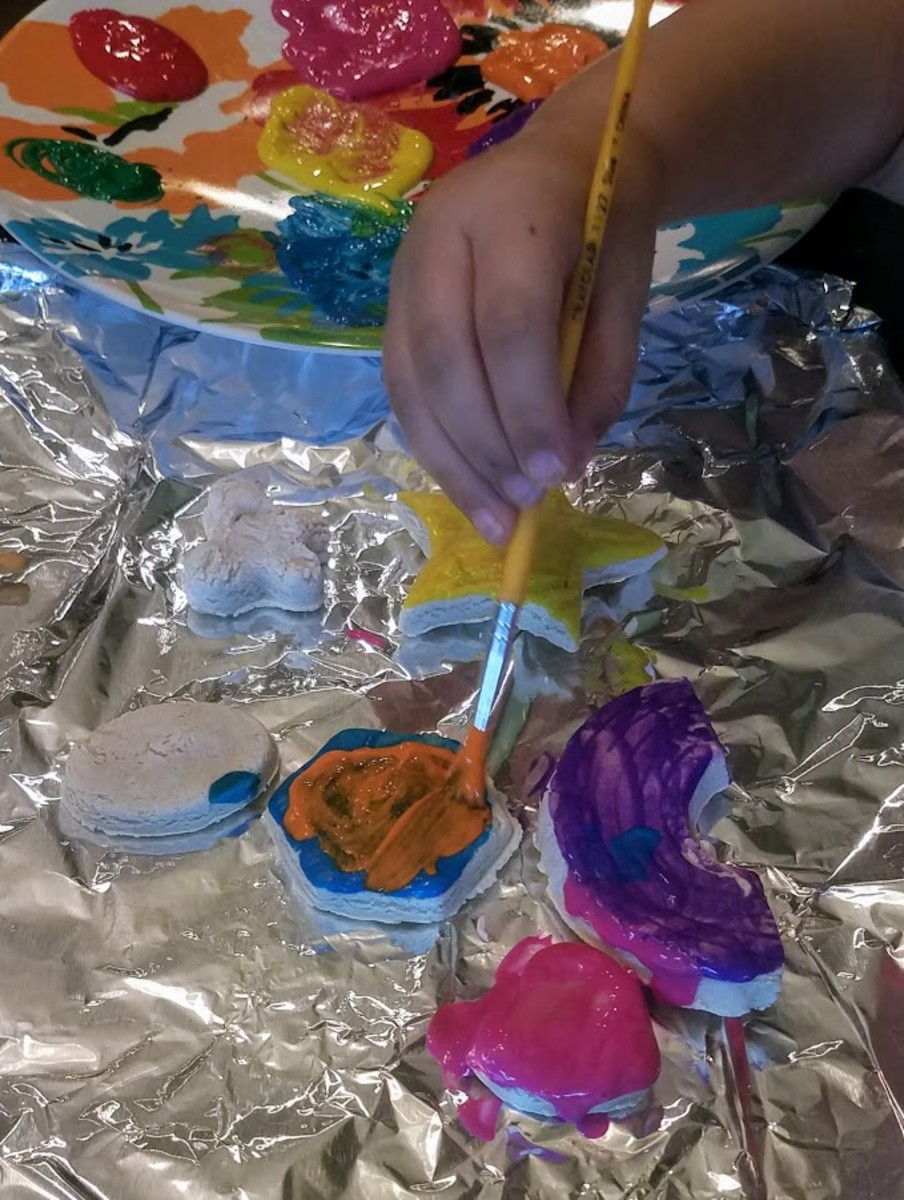 Painting our baked playdough creations!