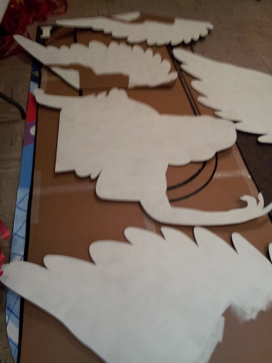 Cardboard angel pieces painted with gesso Courtesy Rural Girl Graphics