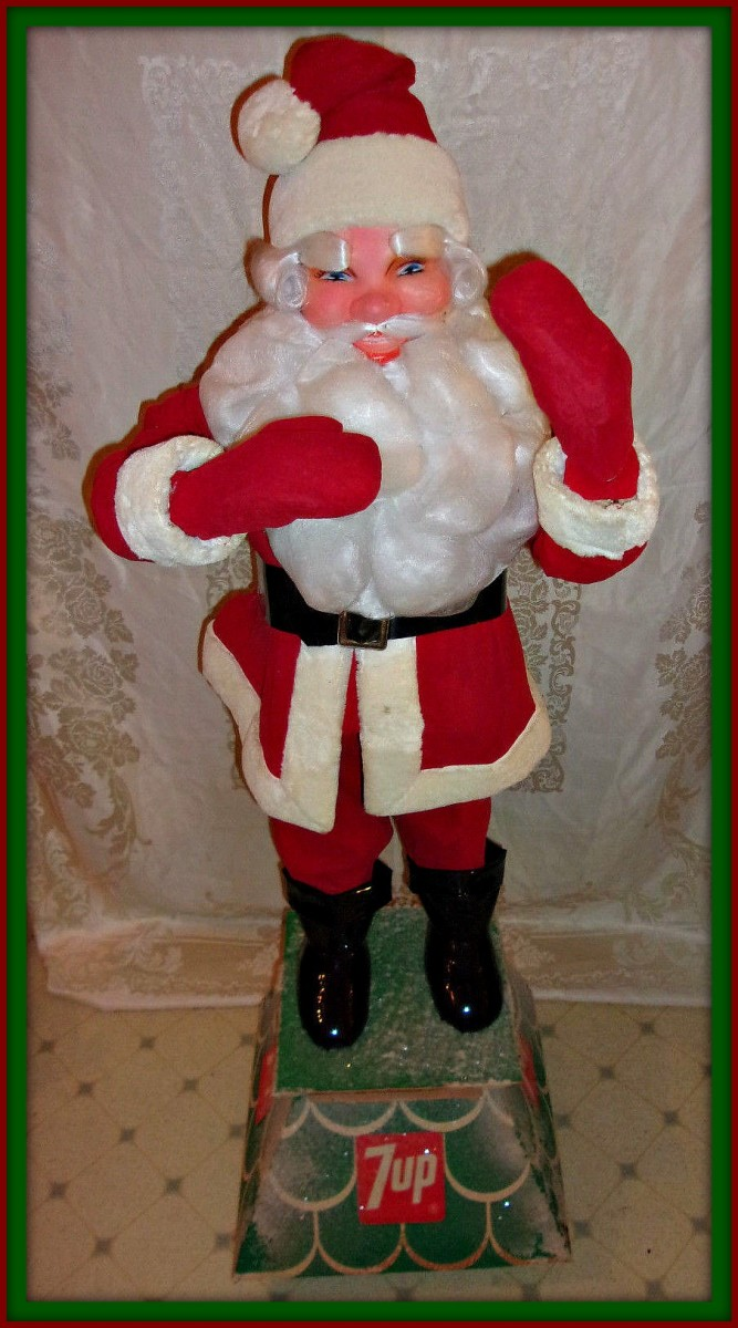 This is a nice vintage advertisement Santa and he is 51 inches  tall including the stand ... and the stand is 16 inches square.
