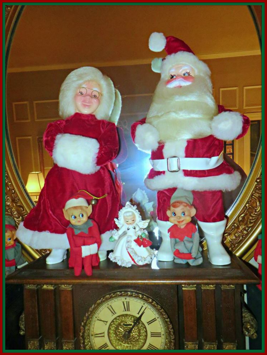 Santa and Mrs. Claus are so happy to be out of that box and over a nice warm fireplace ...  These tow are so fun to display together on the mantle at Christmas time.