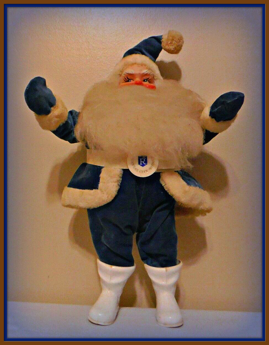 This is a wonderful 14 inch Royals Santa Claus, he was made by Harold Gale for the Kaufman Foundation Dinner after the Royals won the world series in 1980. This Santa is in a velvet Suit that is royal blue, & he has a nice KC Royal emblem on his belt