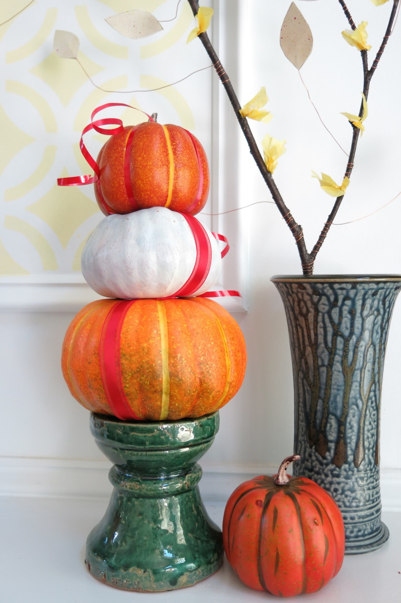 You can make a smaller stacked pumpkin topiary to decorate your mantle.