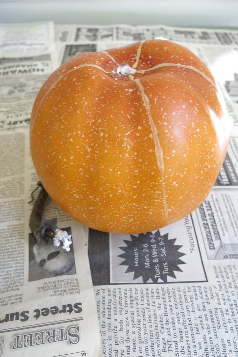 Remove the stems from your pumpkins to begin making a stacked pumpkin decoration.