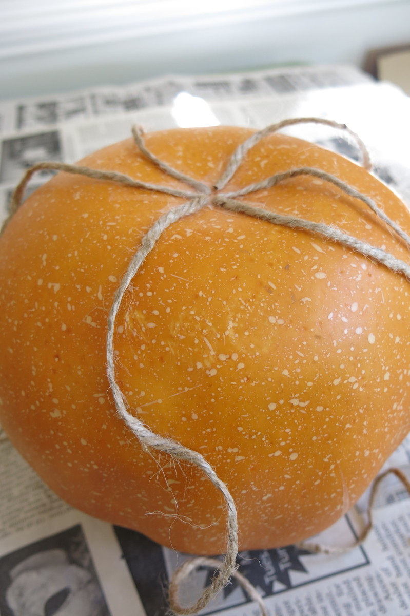 Wrapping your pumpkins with twine, ribbon, or string.