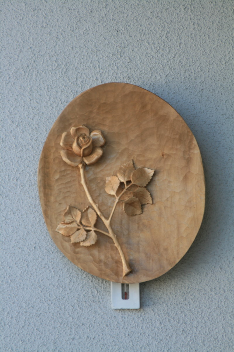 A bowl with a rose all made from one piece. It was made for a man's Aunt who lives in Switzerland. Note that the stem is elevated.