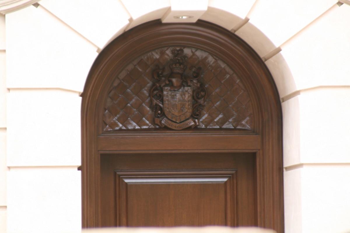Coat of Arms over doorway.