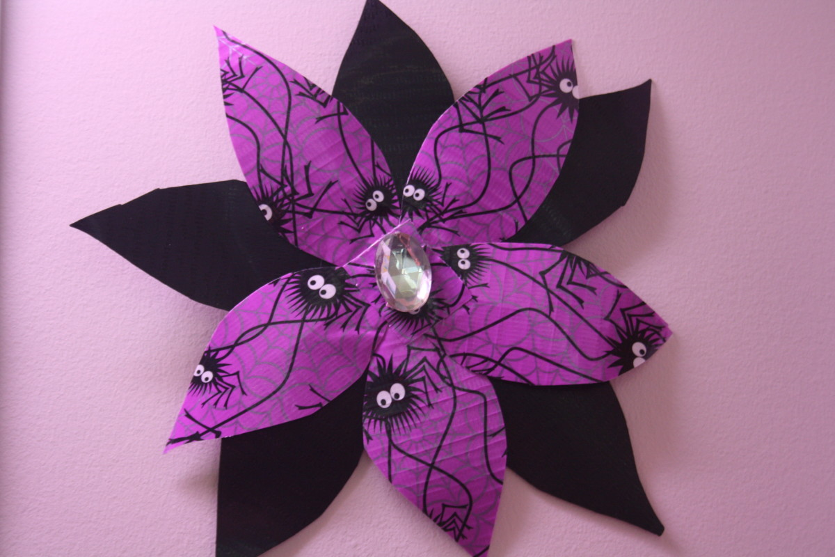 Halloween spider print and black Duct Tape with a jem taped in the center.