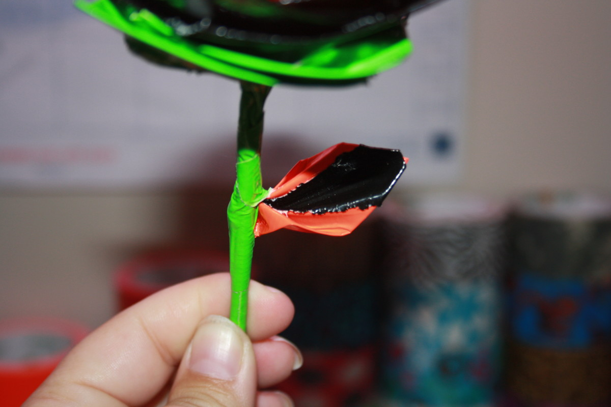 Wrap the duct tape tightly around the stem and your leaf is now attached.  Do the same with the other leaf.