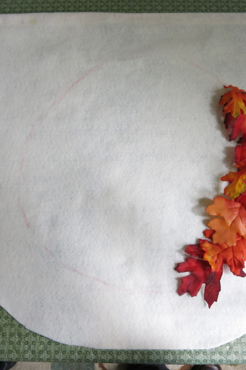 Laying out your leaves for your fall wreath banner