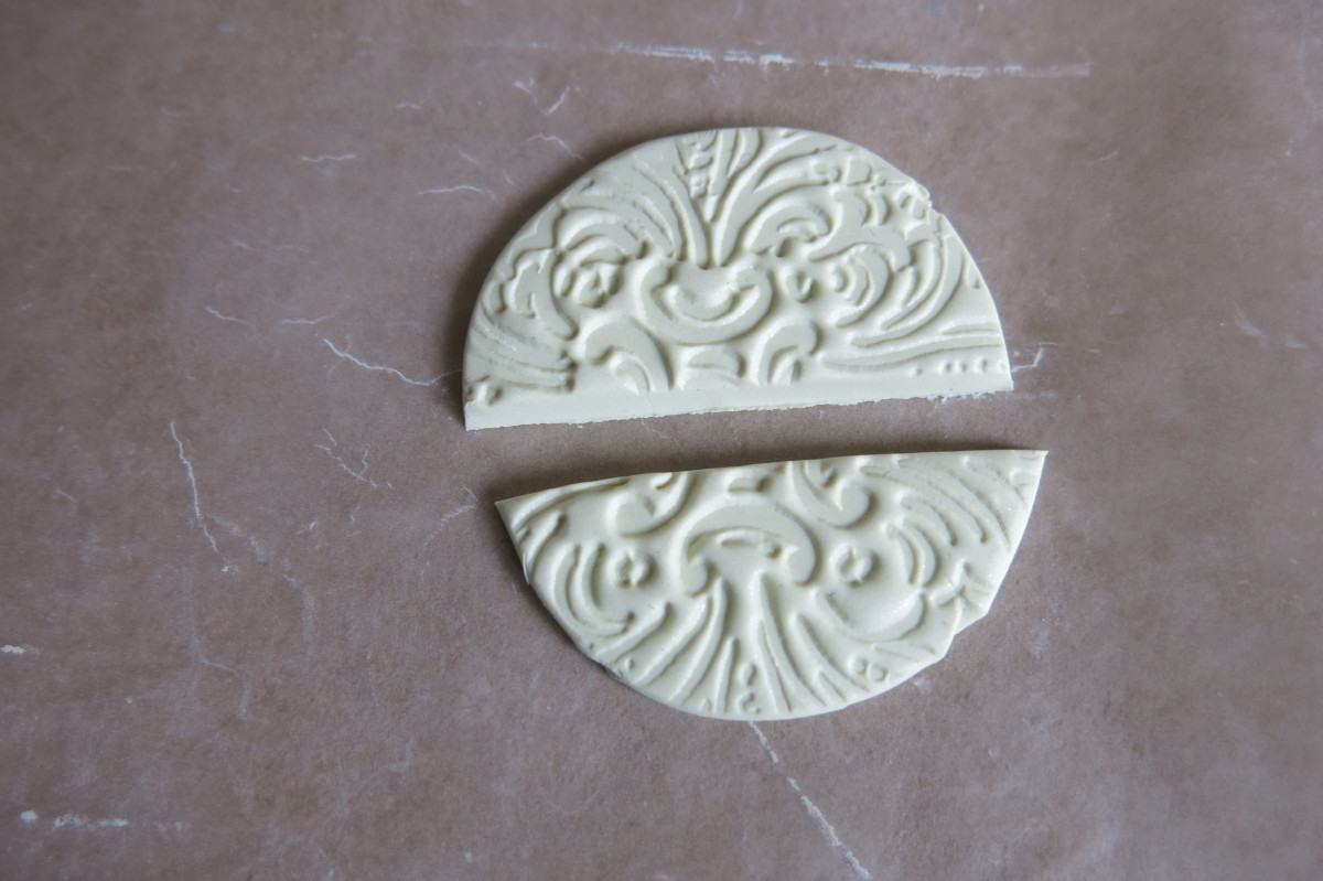 Stamping your clay to make a design for your bird's wings.