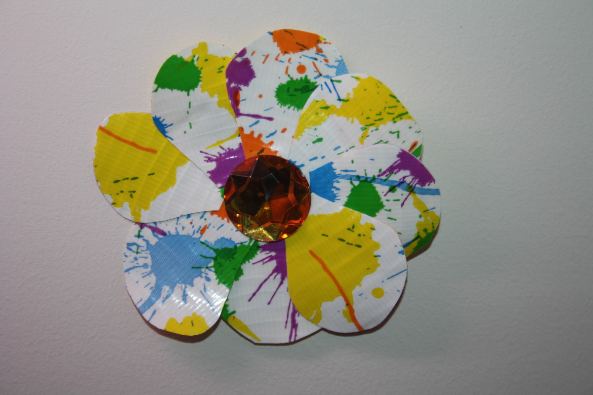This splatter paint flower will be attached to a hair clip for my daughter.