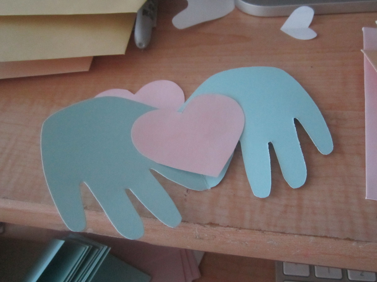I created this little hand card by tracing my son's hand while he was asleep and creating a template of his hand haha.