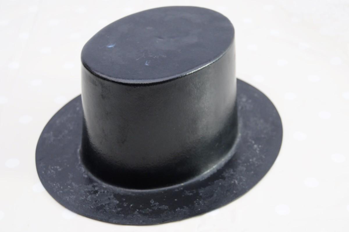 A hard plastic hat shaper