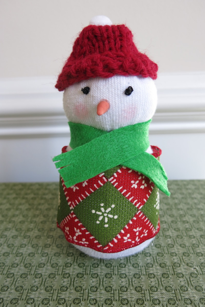 Adding accessories to a female sock snow figure