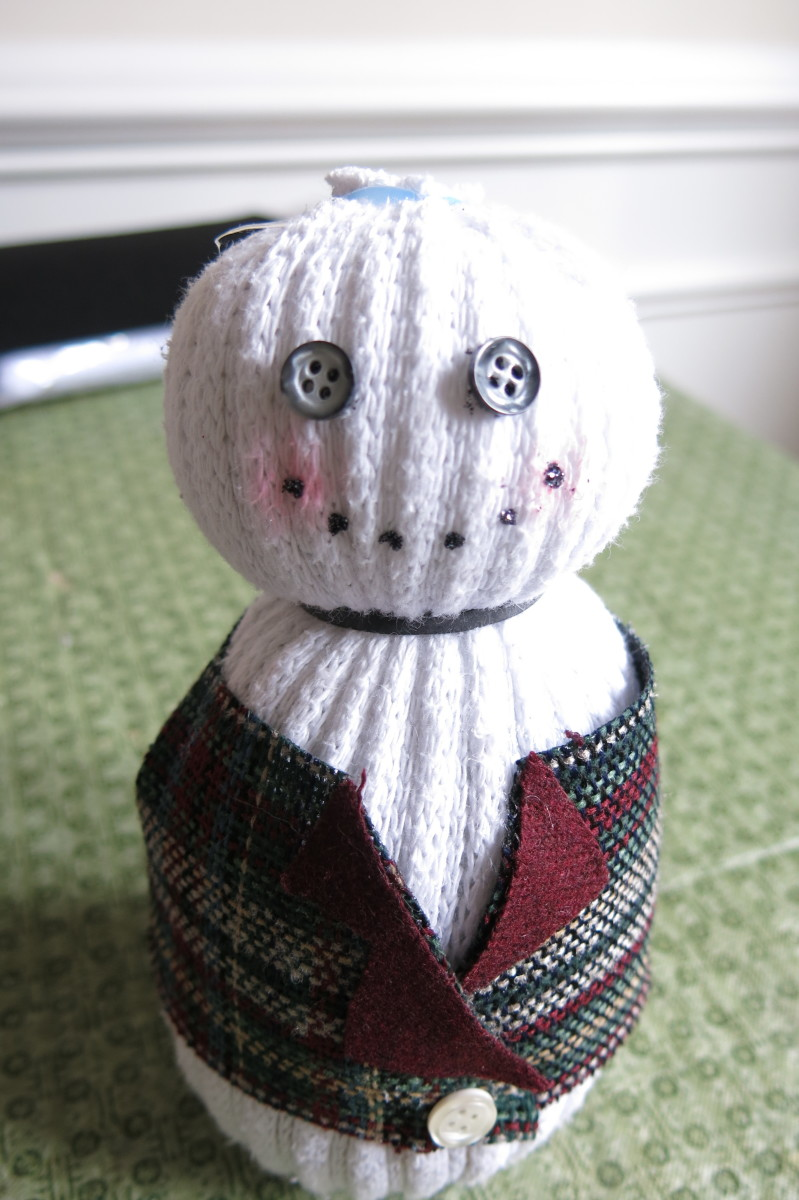 Adding facial features to your sock snowman