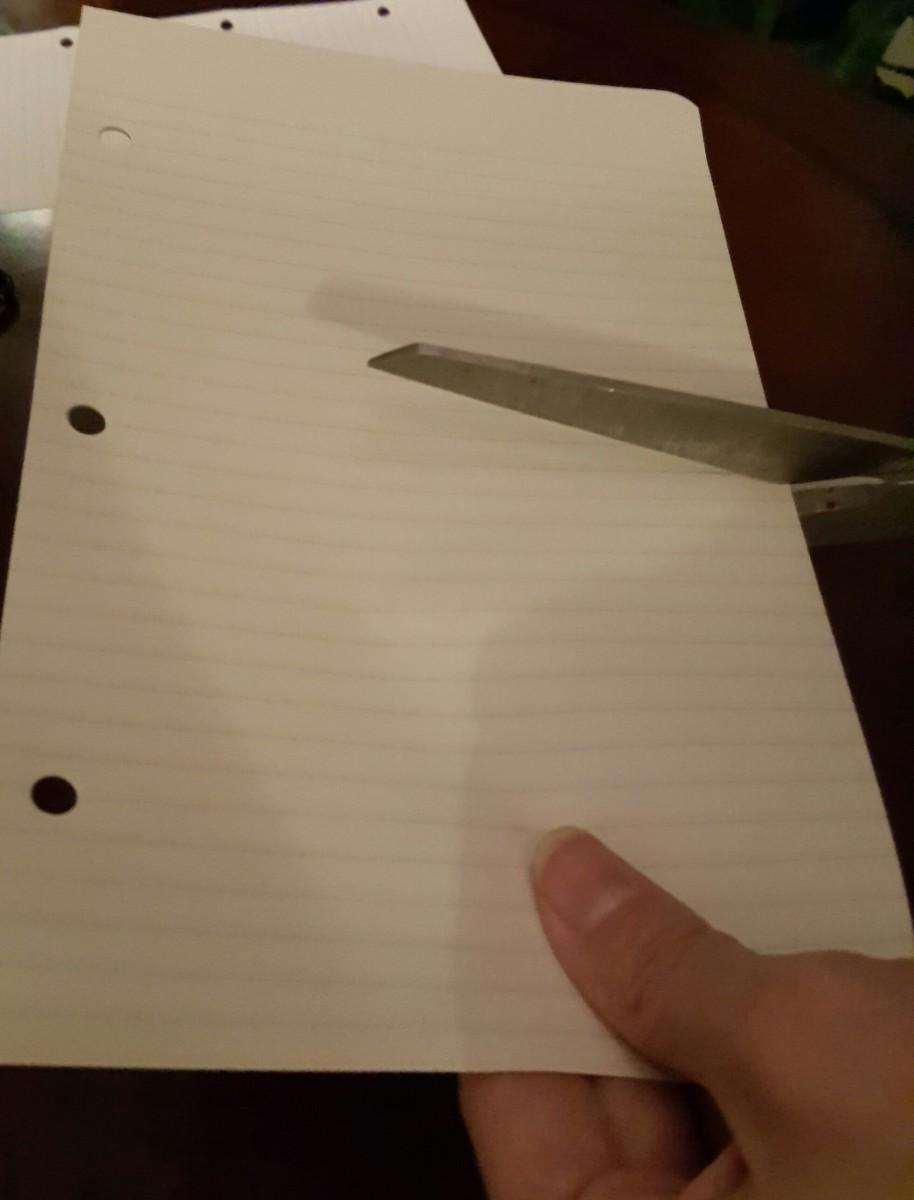 Cut paper in half.