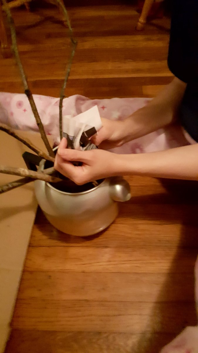 Crumple paper and arrange around your branches to help hold them in place.