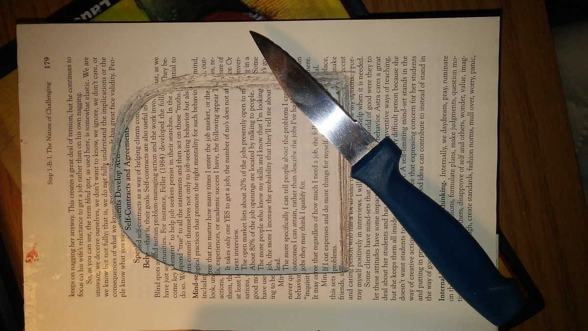 Cutting into the book for the windows.