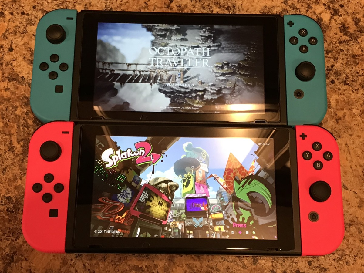 Two Nintendo Switches. The top shows Octopath Traveler and features two neon blue Joy-Cons. The bottom shows Splatoon 2 and features two neon pink Joy-Cons.