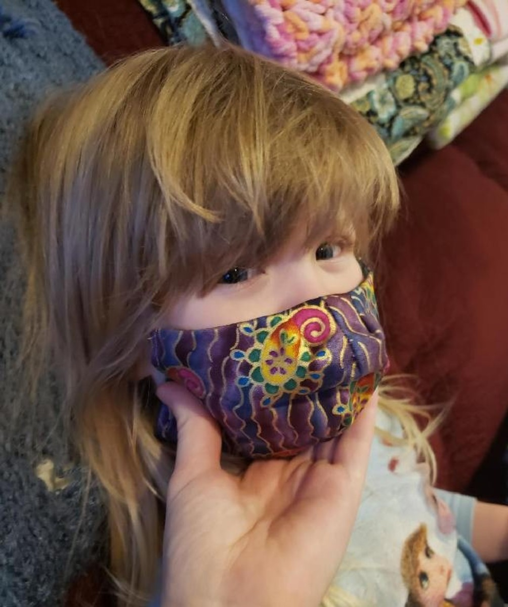 This shows a three-year-old in size small mask—I made an extra small pattern after seeing her in the small size.