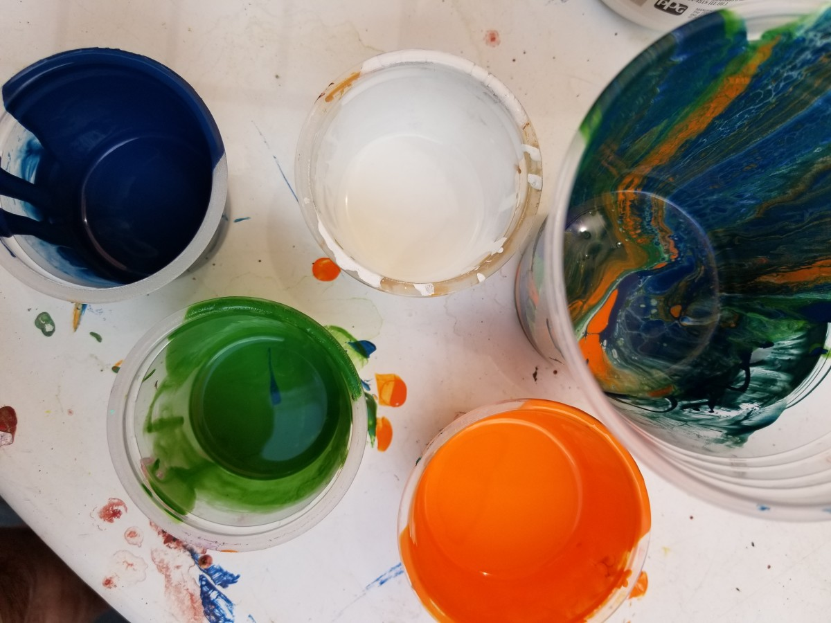 You'll want a good supply of small plastic bathroom-size cups. Pour one paint color per cup.