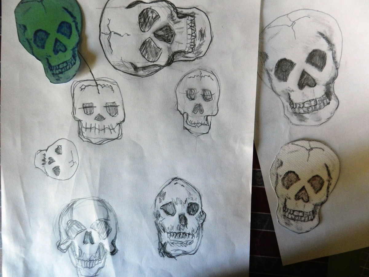 Here are a few of my doodles as I practiced my skull drawings