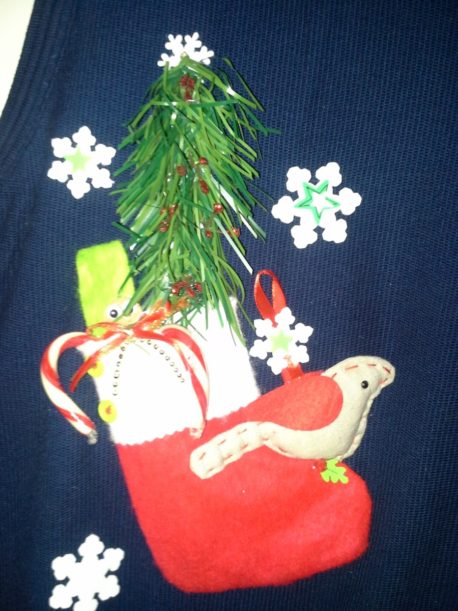 Cotton sweater vest with Christmas ornaments hot glued on.