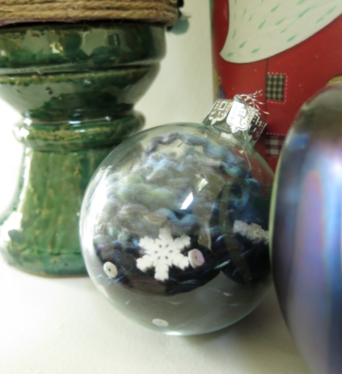 Christmas decoration using a clear ball and yarn