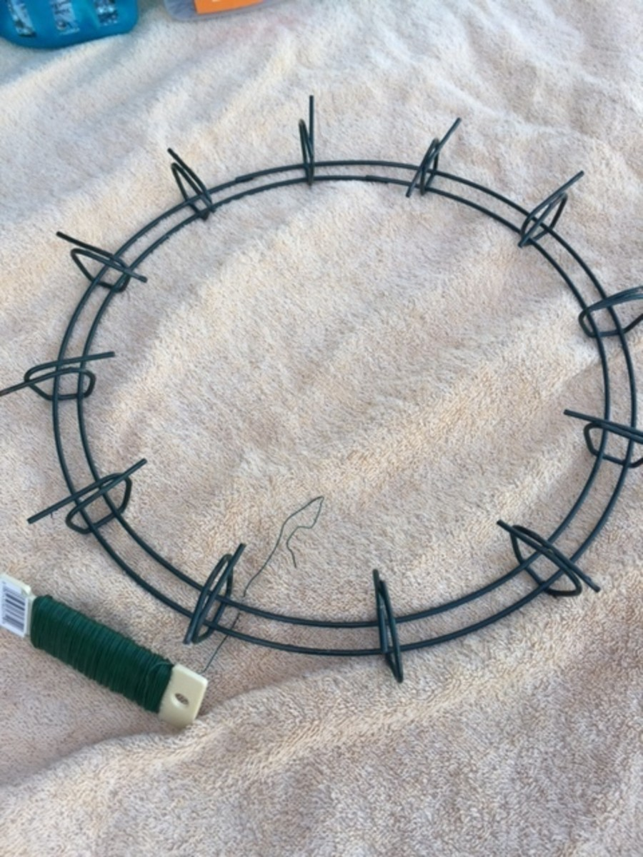 Secure peddle wire to wire wreath.