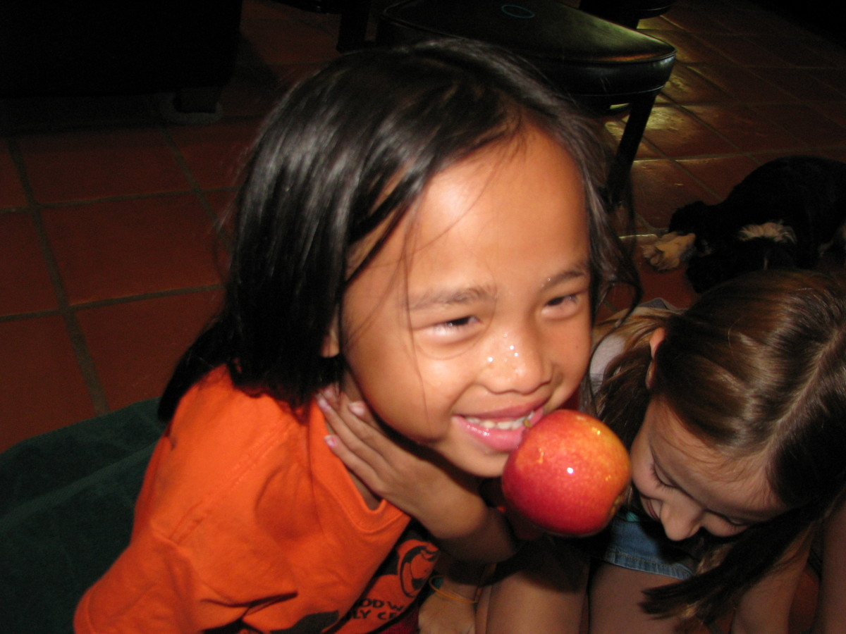 Bobbing for Apples. If a birthday is around a holiday, use some of the popular games and themes of that time of year, like apple bobbing in the Fall, or Egg Hunting in the spring.