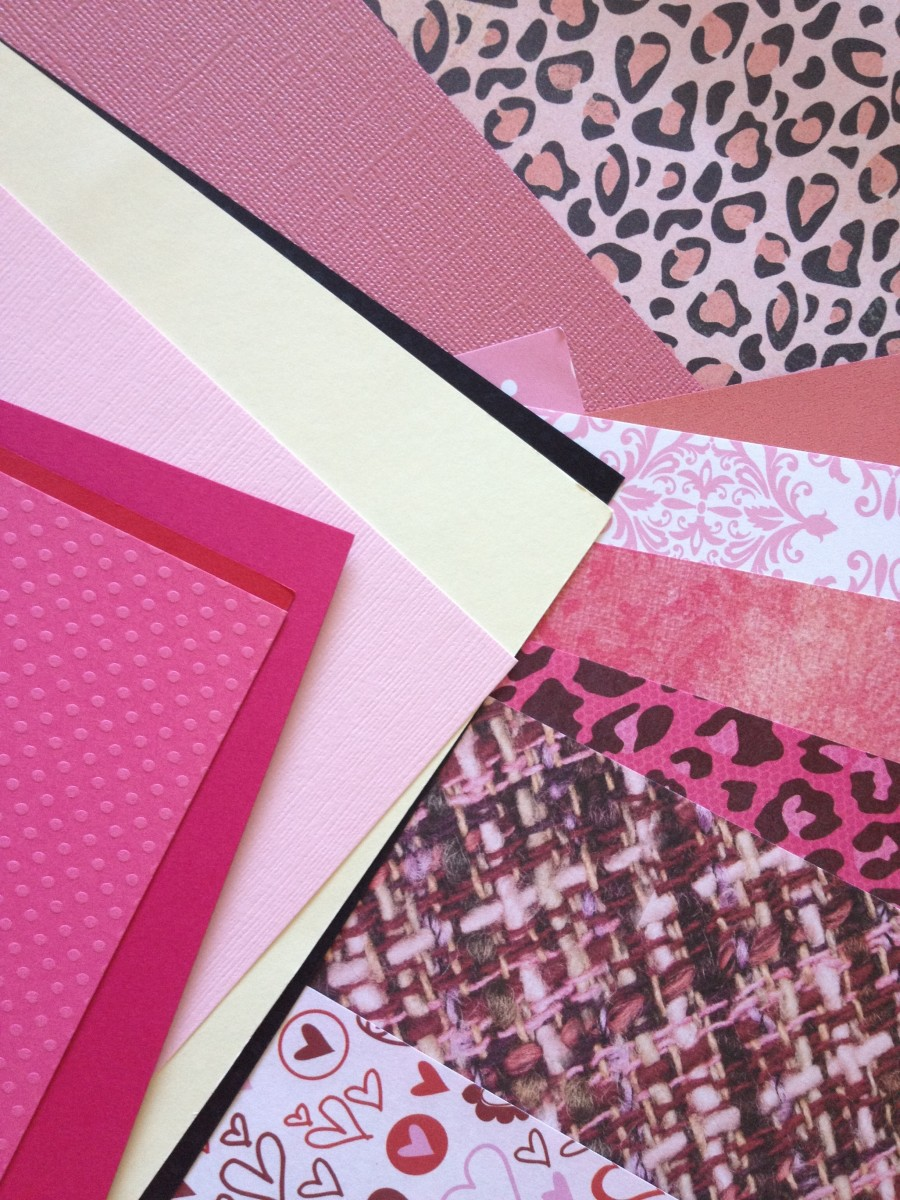 Colorful cardstock and scrapbook papers in perfect shades and patterns for Valentine's Day crafting.