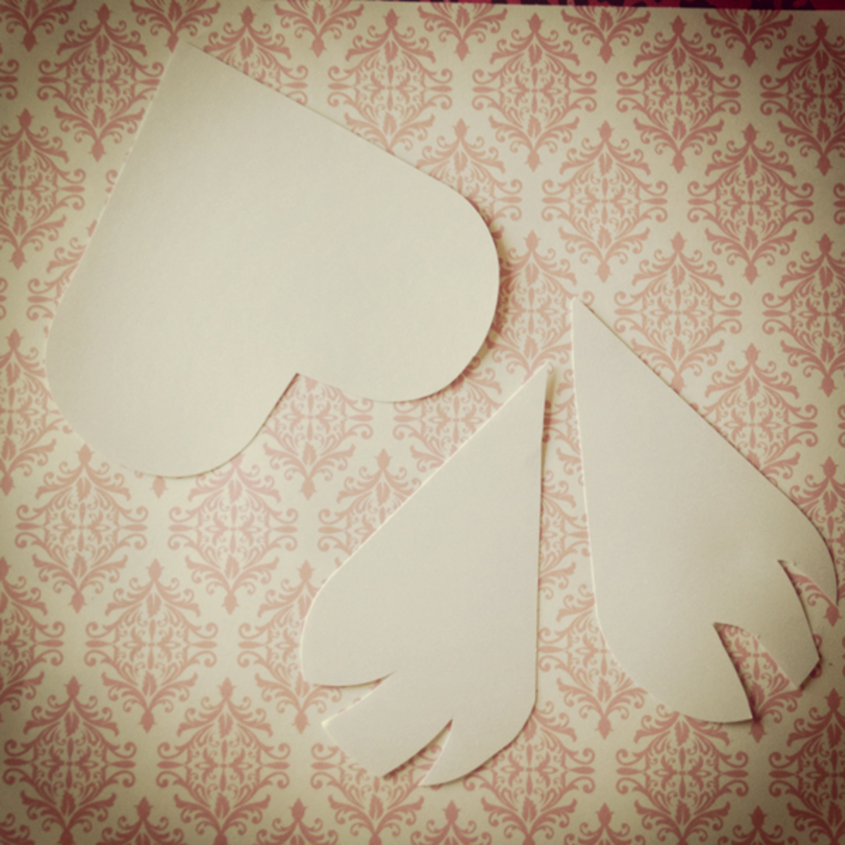 Turn a diecut cardstock heart into a pair of owl wings with a few quick snips!