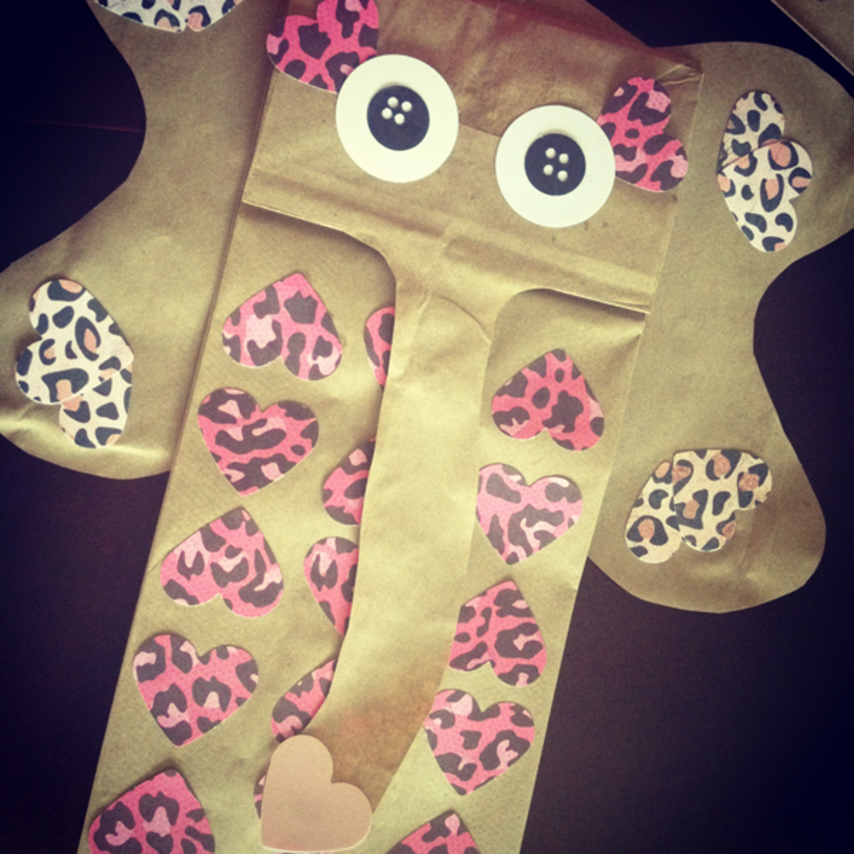 Use a total of three paper bags-- 1 for body, 1 for ears, 1 for trunk.  Use hole punch to simulate button eyes.