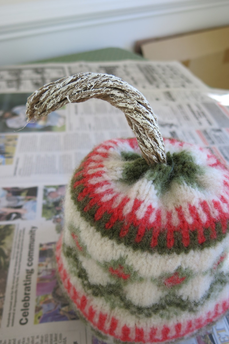 You can trim and paint your stem to finish your felted pumpkin.
