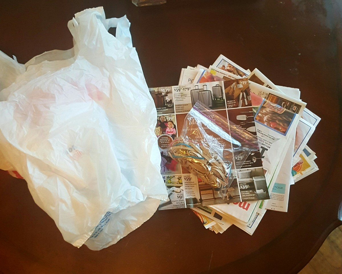 Plastic grocery bags, old ads and newspaper, rubber bands - Materials needed to make your pumpkin.