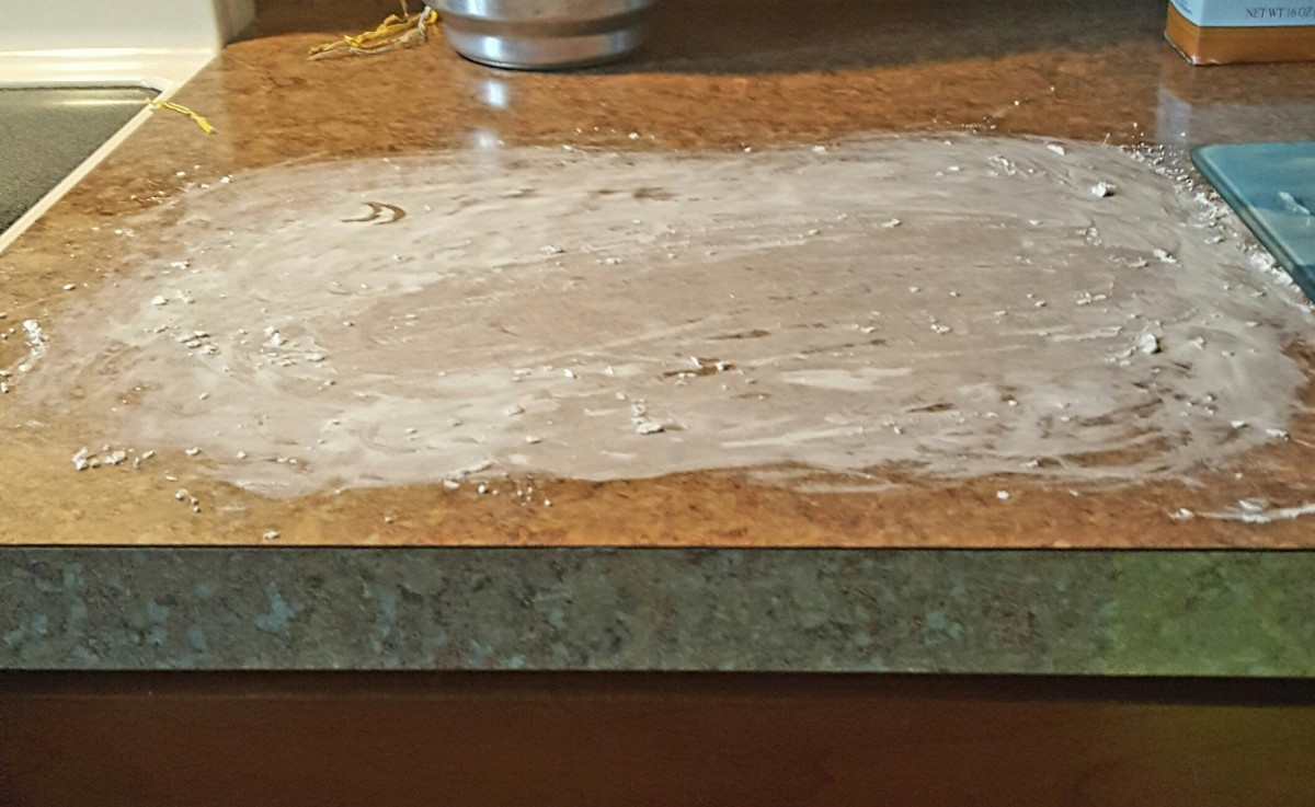 Sprinkle your work area with cornstarch. My son had fun with this step. This is a messy, fun project!