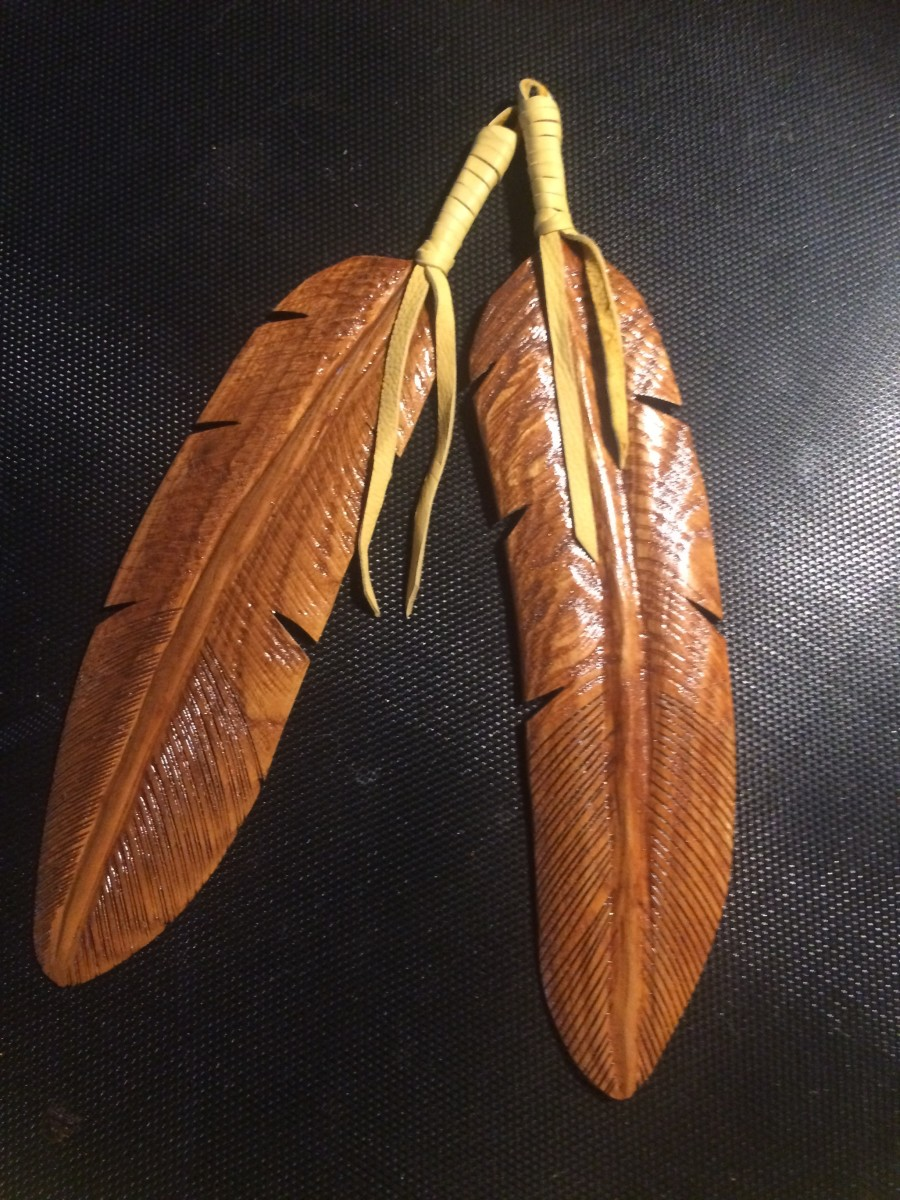 Carved rendition of eagle feathers, a Native American symbol of unity.