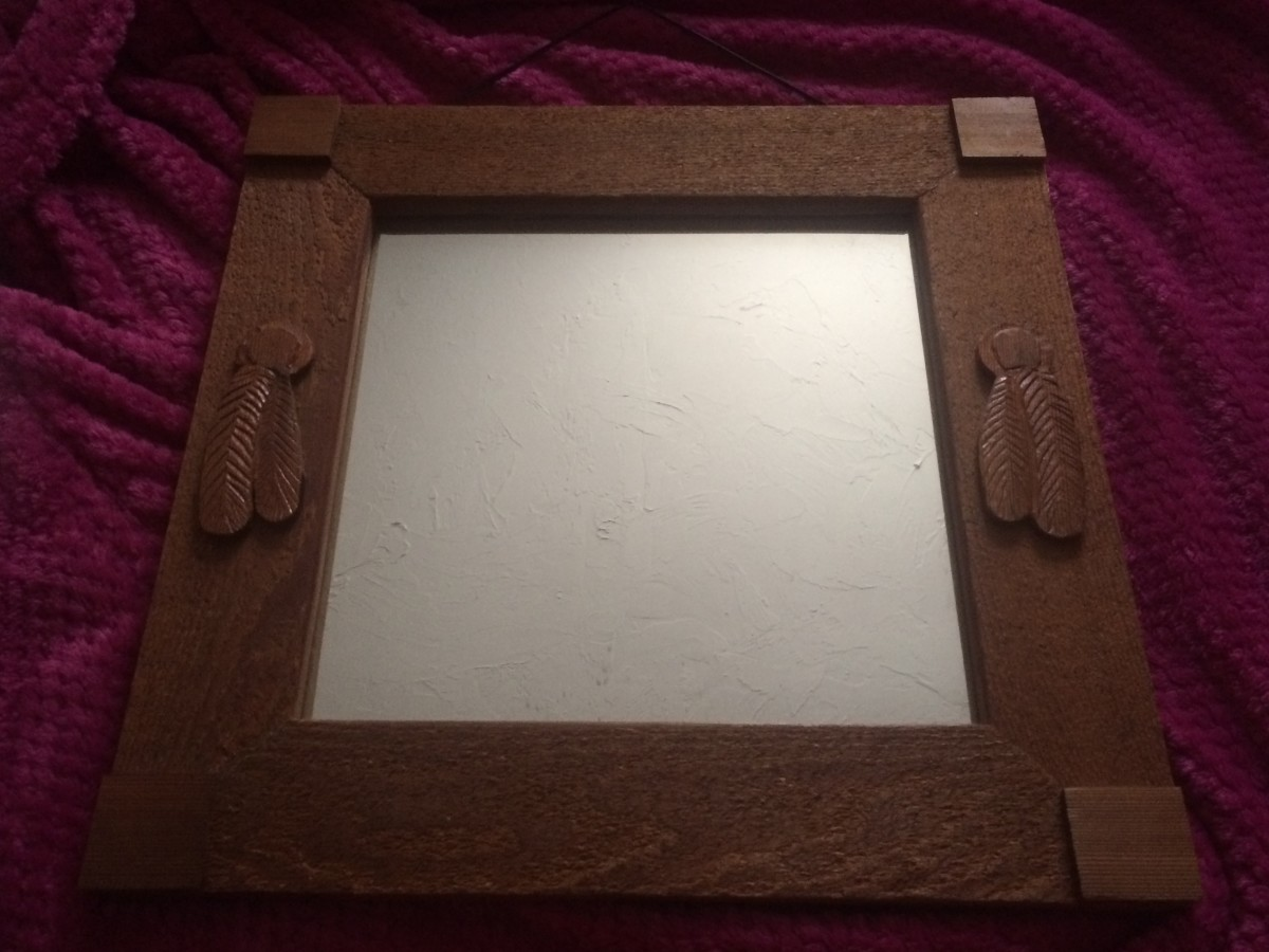A rustic mirror pieced together with scrap wood.