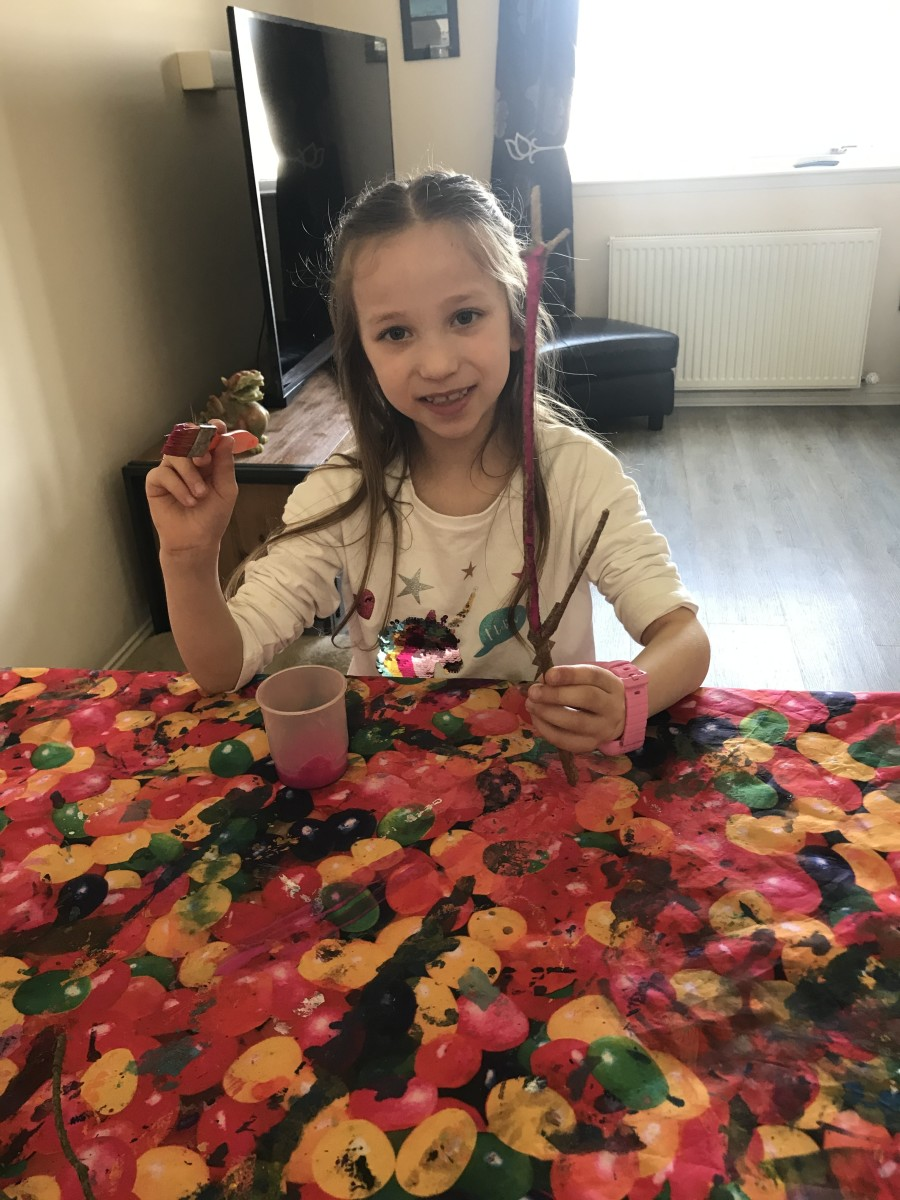 Painting twigs for an Easter Tree
