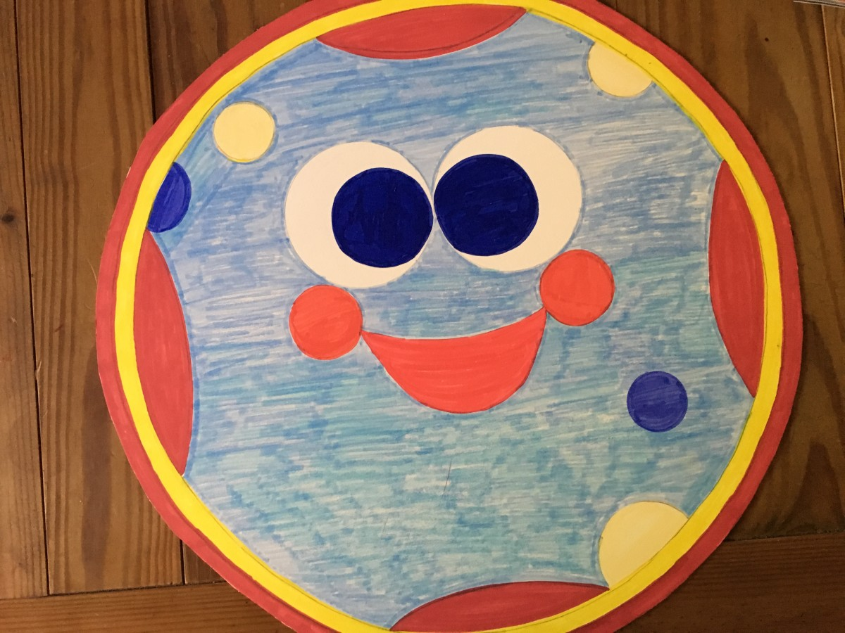 Red and Yellow Sharpies were good for the outside circles so were not covered with felt. My picture was colored because Plan A did not work!  Draw the designs on the poster board with pencil and outline with black marker so they are easy to trace