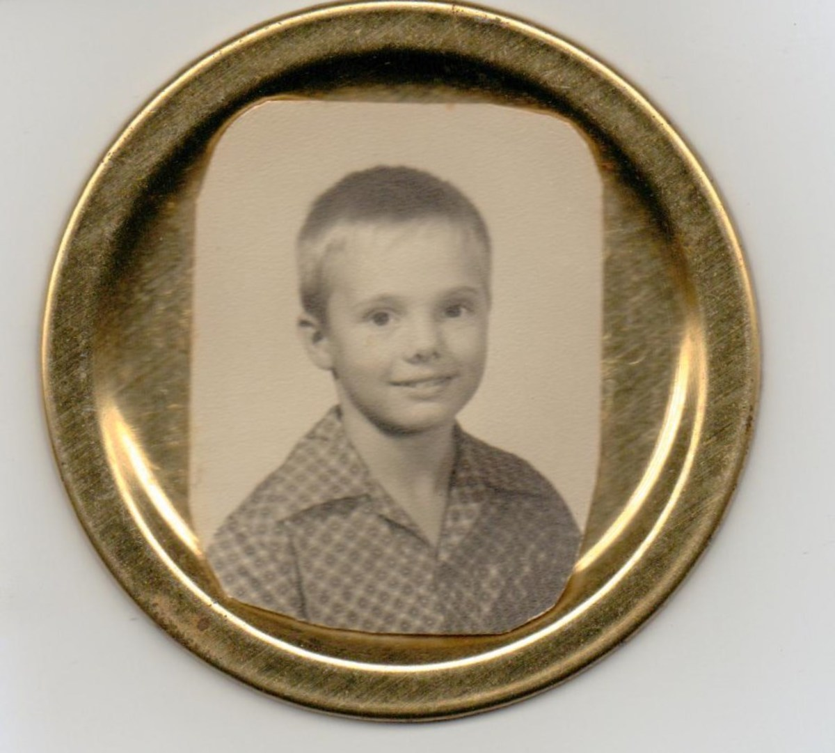 Here Mom used a school photo of my older brother glued to a canning jar lid.